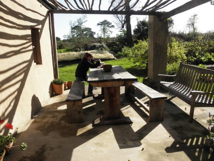 My mom relaxing outside at Fynboshoek Cottage