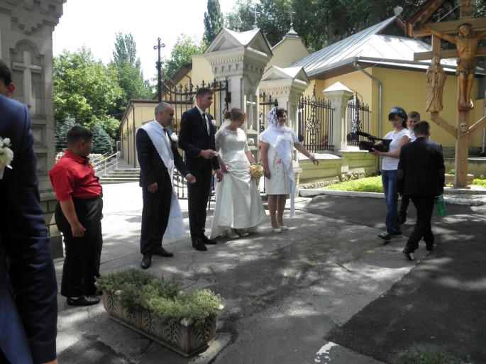 Walking over the water to exit the church grounds, following the church ceremony