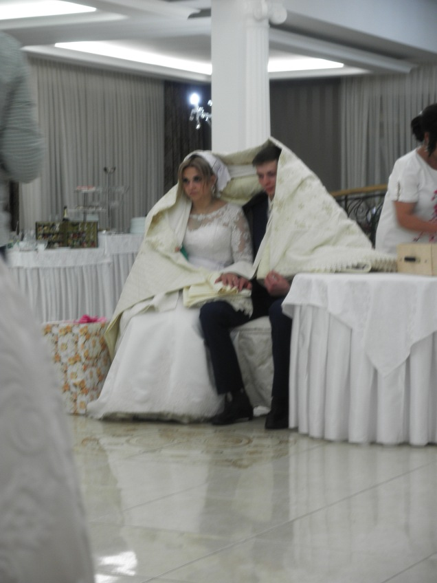 The bride and groom being presented by their gifts