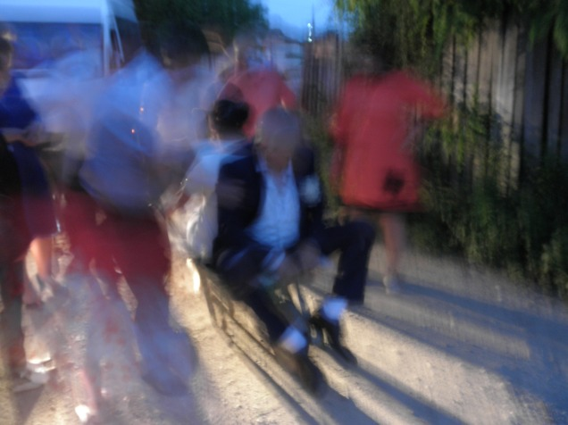 A very blurry photo of my host parents being carted down the road in a wheelbarrow.