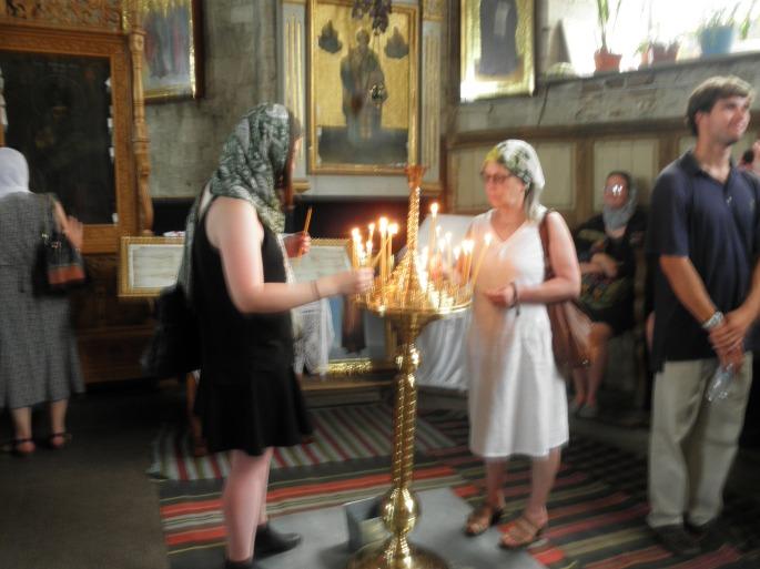 Lighting of candles at Sfantul Nicolae Monastry