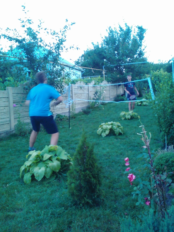 My host brother and host cousin playing badminton.