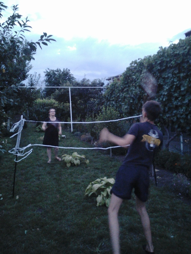Playing badminton against my host cousin.  I lost, and still owe him and my host brother 10 pushups.
