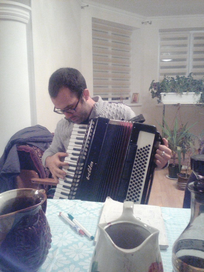 Aaron, one of the other volunteers, attempting to play the accordion