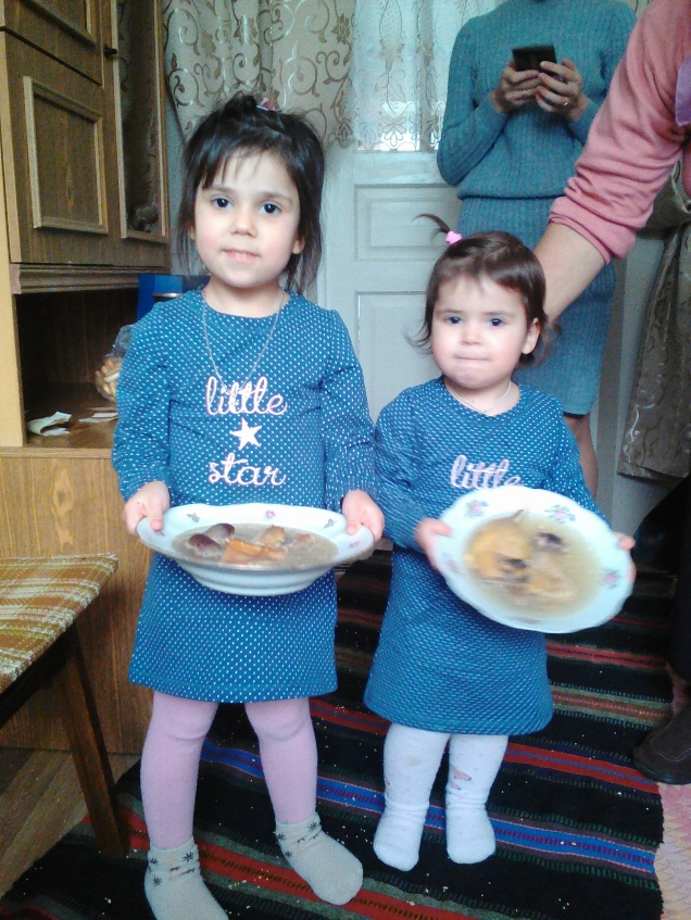 "My host nieces, Sofica and Elisaveta helping set the table for ""old"" New Year"