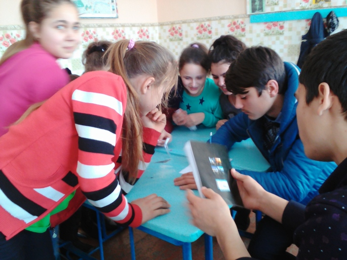 Students work on a grammar exercise during a team competition