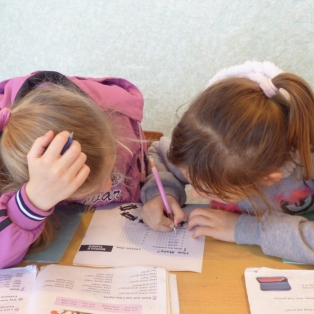 2nd graders working on a worksheet during class