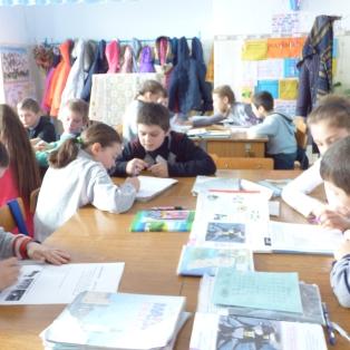 3rd graders working on worksheets during class