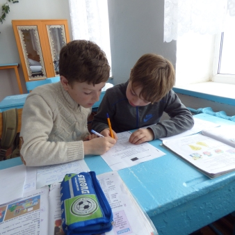 4th graders working on a worksheet during class